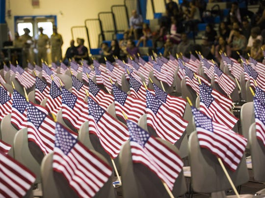 Flags rests on chairs before a naturalization ceremony at South Mountain Community College in Phoenix, Arizona on Tuesday, July 4, 2017. 151 people from 43 countries were sworn in as citizens.