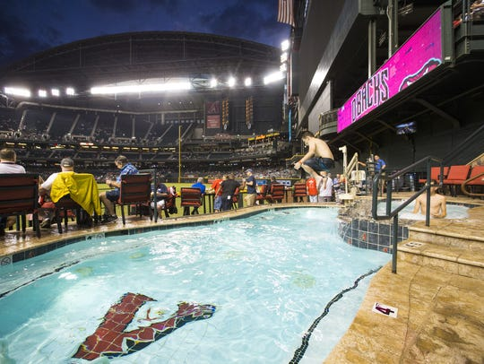 Reed Interdonato, 14, jumps into the Chase Field pool