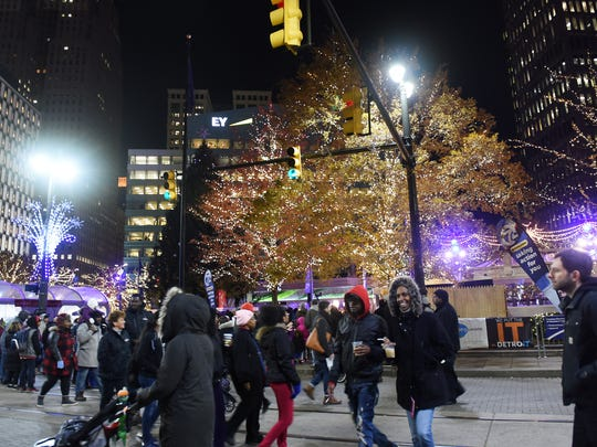 People walk around at the 14th Annual Detroit Christmas
