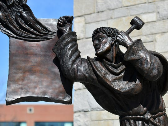 The bronze sculpture of Martin Luther and the 95 Theses by Timothy Schmalz at Historic Trinity Lutheran Church in Detroit on Sunday.