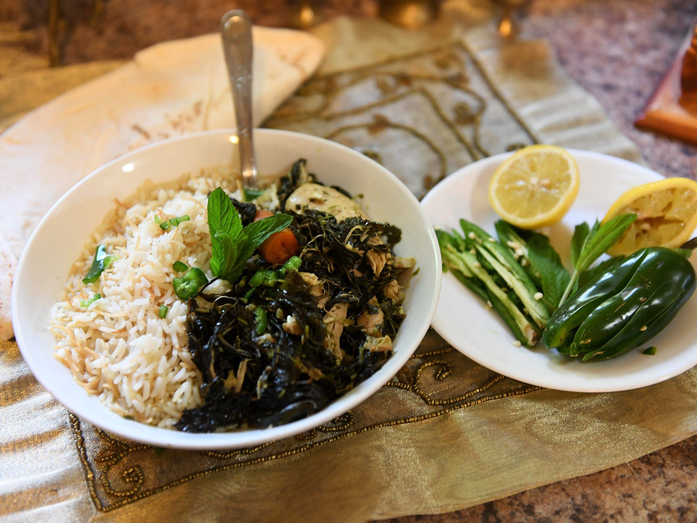 The dish mloukehia made by Summer Homayed with greens,