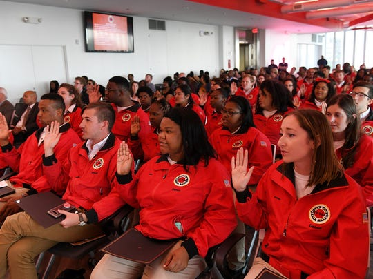 City Year Detroit AmeriCorps members take the City Year Alumni Pledge at the City Year Detroit Graduation at The Beacon in Detroit on June 14, 2018. City Year Detroit AmeriCorps members participate in the lives of students and teachers at public schools in Detroit during their service year.(Robin Buckson / The Detroit News)