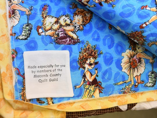 A tag that is placed in charity quilts made by the
