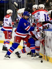Kevin Klein (8) of the Rangers checks Marcus Johansson (90) of the Washington Capitals in the first period Tuesday.
