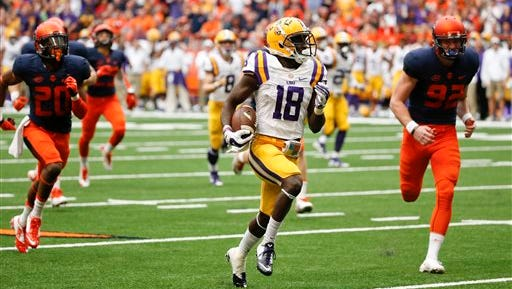 LSU 's Tre'Davious White (18) beats Syracuse punter Riley Dixon (92) and other defenders as he returns a punt for a touchdown during the second half of last season's game.