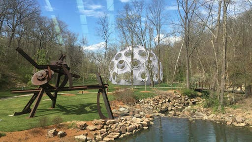 This computer illustration provided by the Crystal Bridges Museum of American Art on Dec. 28, 2016, shows a rendering of how inventor Buckminster Fuller's Fly's Eye Dome will look when installed on museum grounds in Bentonville, Ark. The museum recently told its patrons it intends to construct the futuristic dome in the summer of 2017.