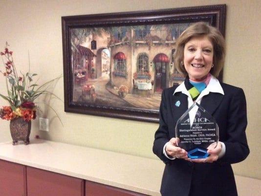 Adrienne's award.jpg