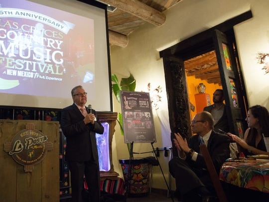 Philip San Filippo, who was then the Las Cruces Convention and Visitors Bureau director, unveils the 2017 line up for the Las Cruces Country Music Festival at La Posta de Mesilla on October 27, 2017.
