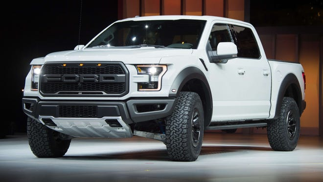 The Ford F-150 Raptor is unveiled during the Ford press conference at the North American International Auto Show in Detroit  on Jan. 11, 2016.