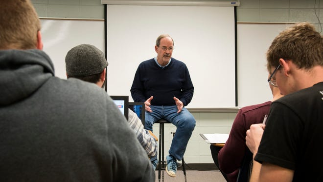 Montreat College English professor Don King leads a literature class on campus last week.
