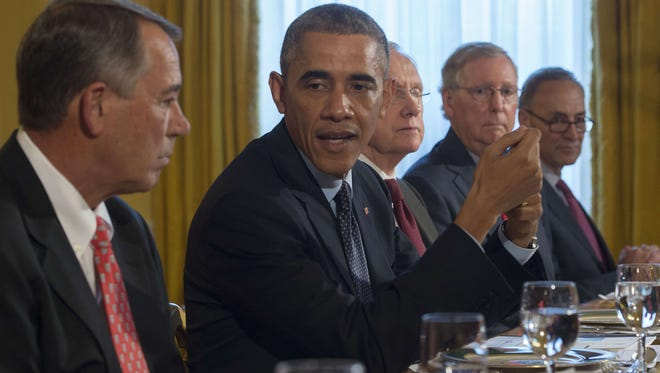 US President Barack Obama (2nd L) meets with Speaker of the House John Boehner, R-Ohio, ( L); Senate Majority Leader Harry Reed, D-Nevada, (C); Senate Minority Leader Mitch McConnell, R-Kentucky, (2nd R); and US Senator Chuck Schumer, D-New York, (R) during a bipartisan, bicameral congressional leadership luncheon at the White House in Washington, DC, November 7, 2014.              AFP PHOTO / Jim WATSONJIM WATSON/AFP/Getty Images ORG XMIT: 522375861 ORIG FILE ID: 535135900