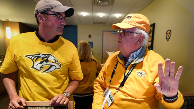 Jon Troxel talks with Nashville Predators owner Tom Cigarran in his suite before the start of game 5 of the Stanley Cup Final against the Pittsburgh Penguins at PPG Paints Arena Thursday, June 8, 2017, in Pittsburgh, Pa.