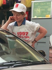 1997: Pattie Glover, one of two contestants left touching the car after 44 hours in the Touch-a-Thon.