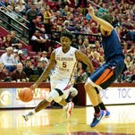 Malik Beasley (5) breaks away during the 69-62 FSU victory against Virginia on Sun., Jan. 17 at the Donald L. Tucker Center in Tallahassee, FL.