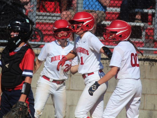 Dixie Heights players Ava Meyer, Maggie Fields and Ella Steczynski celebrate a run-scoring hit during St. Henry's 8-7 win over Dixie Heights in the 34th District softball championship game May 25, 2018 at Dixie Heights High School, Edgewood KY.
