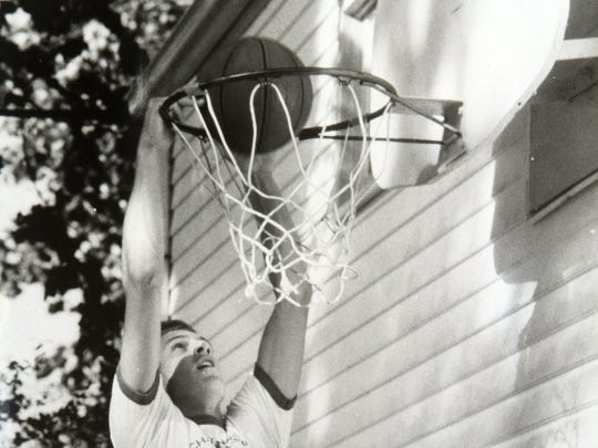 CBA's John Crotty dunks a ball at his family's home in Spring Lake in 1986.