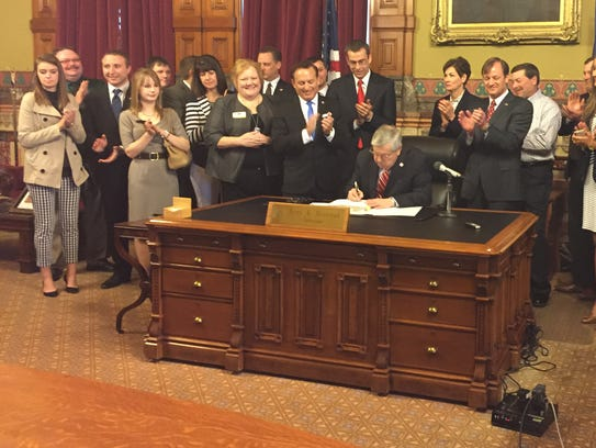 Gov. Terry Branstad signs House File 516, enacting