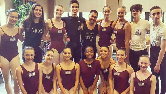 Members of the Vineland Regional Dance Company are pictured with modern teacher Jason McDole: (back row, from left) Lindsay Nakai, Lilly Castellini, Courtney Ricci, Joe Hall Conley, Jason McDole, Alexandra Bisignaro, Angelina Bartolozzi, Trey Luciano and Adam Anthony; and (front row, from left) Nicole Cullis, Elly Petitdemange, Carly Cullinane, Sydney Jones, Elika Imanaga, Isabella Hill and Lindsey Wettstein.