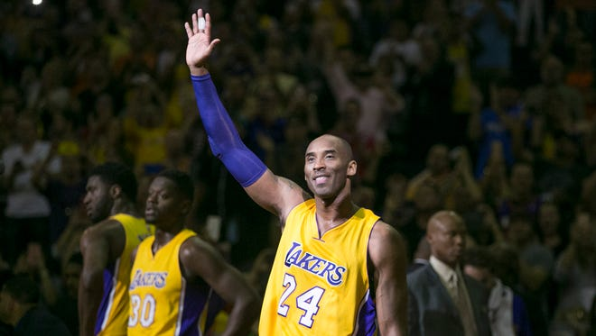 The Lakers' Kobe Bryant waves to the crowd during the first quarter of the NBA game against the Suns at Talking Stick Resort Arena in Phoenix on Wednesday, March 23, 2016. This was Bryant's last game against the Suns in Phoenix.