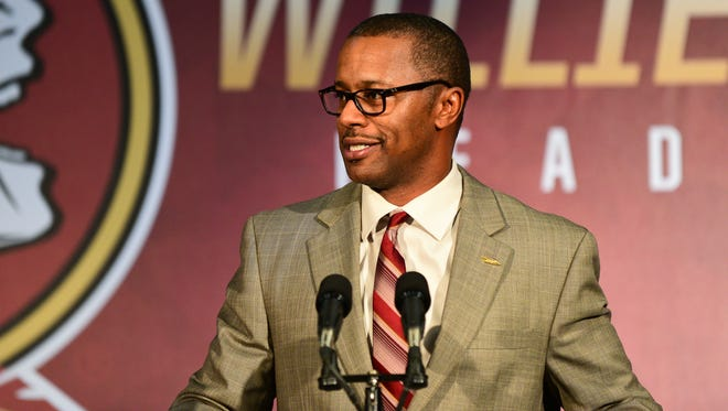 Florida State's new head coach Willie Taggart speaks to media and the guests at his first press conference at Doak Campbell Stadium.