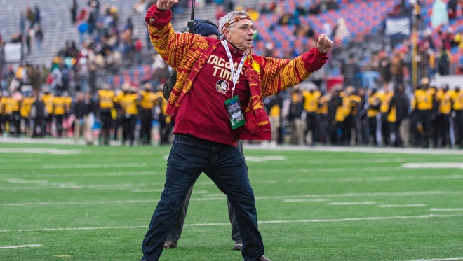 "Florida State fan Mark Bartell, also known as ""The Dancing Dad"", competes in a dance off during the fourth quarter of the Independence Bowl."