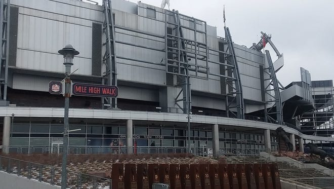 Sports Authority signage at Mile High Stadium has been stripped.