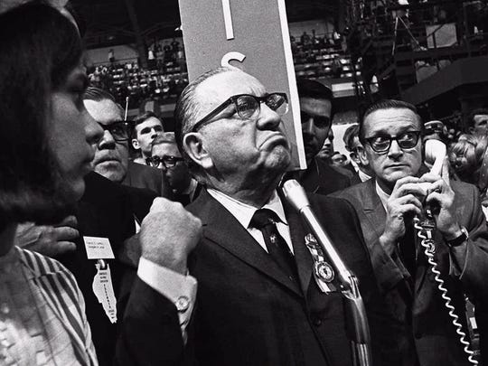Mayor Richard J. Daley stands at the microphone as shouts resound through the International Amphitheatre during the Democratic National Convention in this Aug. 28, 1968, photo.