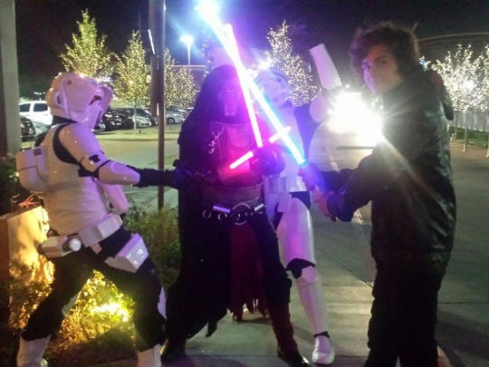 C.J. Strebin, right, with Star Wars The Force Awakens characters.