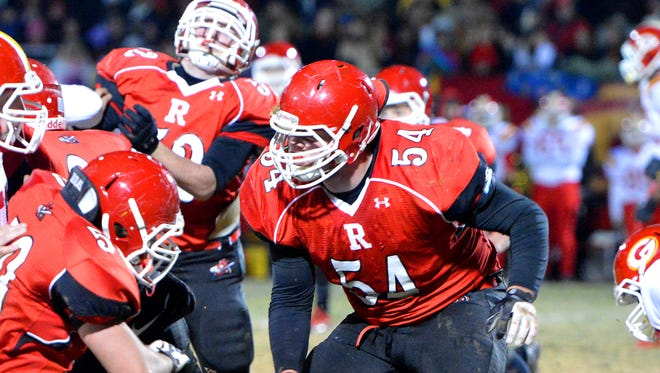 Riverheads' Mike Herndon tries to reach the Goochland ball carrier during a football game played in Greenville on Friday, Nov. 29, 2013.