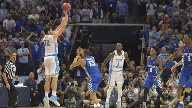 North Carolina Tar Heels forward Luke Maye (32) makes a basket with .3 seconds left over Kentucky Wildcats guard Isaiah Briscoe (13)  in the second half during the finals of the South Regional of the 2017 NCAA Tournament at FedExForum on March 26.