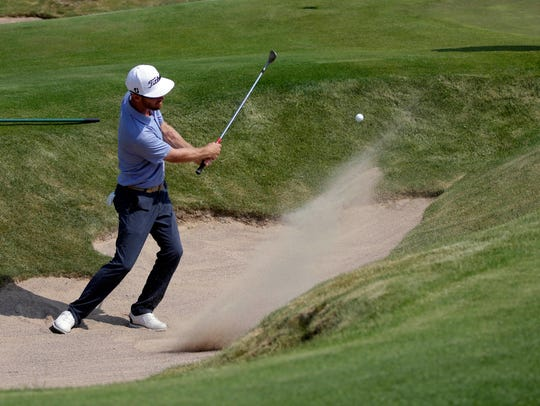Nick Flannigan chips out of a bunker off the ninth