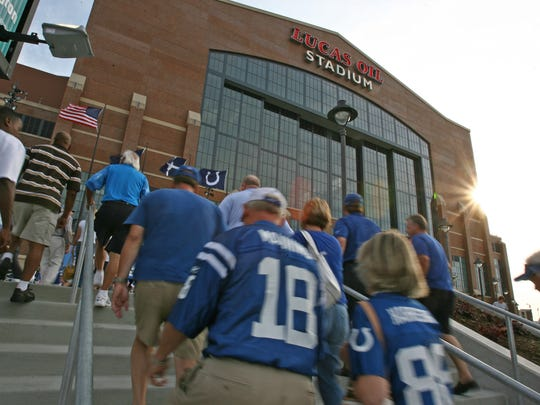 Fans head toward the stadium before Buffalo Bills at the Indianapolis Colts, preseason, the first NFL action at Lucas Oil Stadium, Indianapolis, IN, Sunday, August 24, 2008.  (Robert Scheer/The Indianapolis Star)