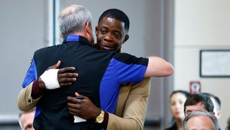 James Shaw gets a hug from Waffle House CEO Walt Ehmer during a press conference on the Waffle House shooting  April 22, 2018 in Nashville, Tenn.