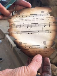 Cheryl Lewis found a burned piece of sheet music in