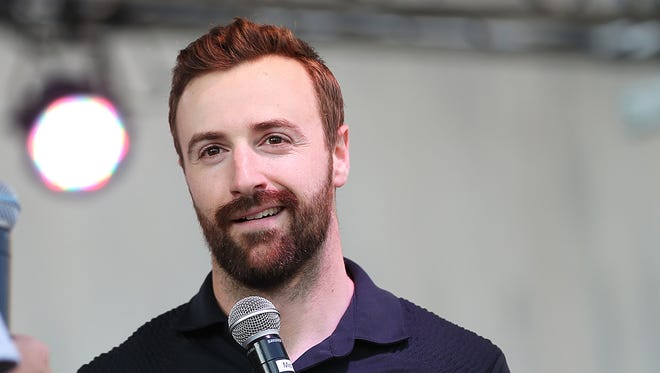 From left, IndyCar driver James Hinchcliffe makes an appearance at Curt Cavin's annual Carb Night Burger Bash, held downtown for the first time ever at the Pan American Plaza, Indianapolis, Friday, May 27, 2016.