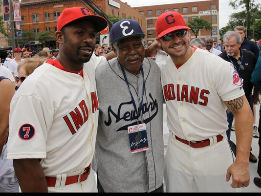 Cleveland Indians' Michael Bourn, left, Ted Toles, and Nick Swisher are all smiles after the unveiling of a statue of Hall of Fame Larry Doby Saturday, July 25, 2015, in Cleveland. Doby broke the color barrier in the AL on July 5, 1947, just months after Jackie Robinson played for the Brooklyn Dodgers. Toles played in the Negro Leagues and with the Pittsburgh Crawfords, Newark Eagles, Cleveland Buckeyes and Jacksonville Eagles from 1946-1947 and in 1949. (AP Photo/Tony Dejak)