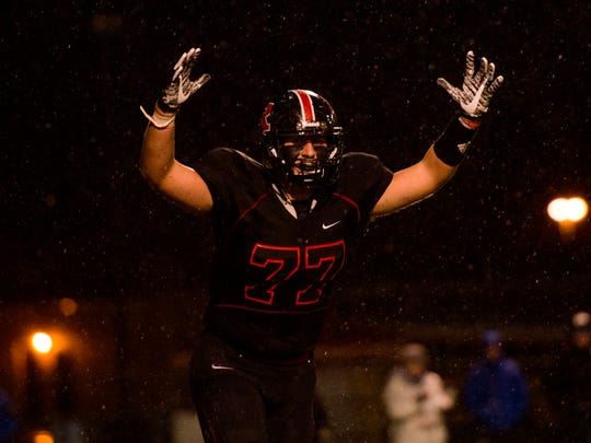 Rossview lineman, 77, lifts his hands after a touchdown