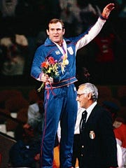 Ed Banach accepting his gold medal during the 1984