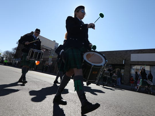 The Bergen Irish Pipe Band marches north on Washington Avenue during the St. Patrick's Day parade in Bergenfield on Sunday, March 11, 2018.