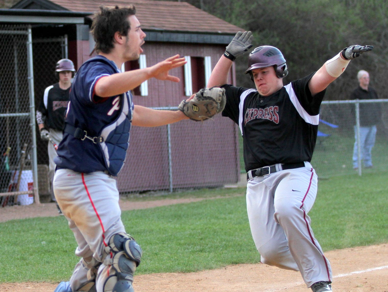 Elmira's Cole Berry scores the tying run in the seventh inning as Binghamton catcher Dan Walsh waves off the throw in Thursday's STAC game at Ernie Davis Academy.