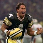 Brett Favre celebrates after throwing a touchdown pass in  Super Bowl XXXI FILE - This Jan. 26, 1997, file photo shows Green Bay Packers quarterback Brett Favre celebrating after throwing a touchdown pass to Andre Rison during first quarter action at Super Bowl XXXI in New Orleans. The great thaw in Green Bay is nearly complete. Former quarterback Brett Favre is scheduled to be inducted on Saturday into the Packers Hall of Fame (AP Photo/Doug Mills, File)