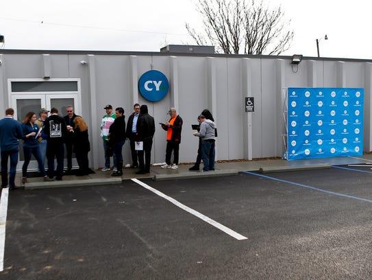 People wait outside the CY+ Medical marijuana Dispensary