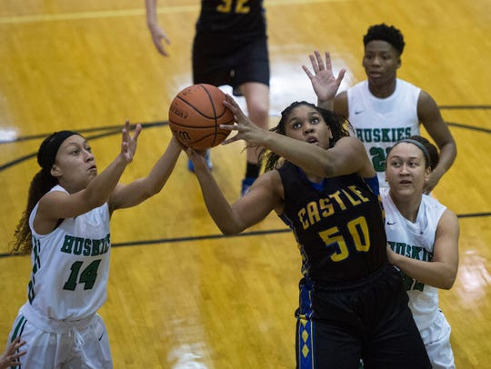 Castle's Jalaya Dowell (50) pulls down a rebound in the Knights' 41-37 victory over North in the Class 4A Central Sectional title game on Feb. 3.