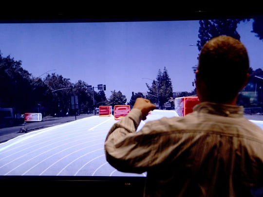 Danny Shapiro, senior director, watches a video screen showing the data collected by self-driving cars using their technology at Nvidia.