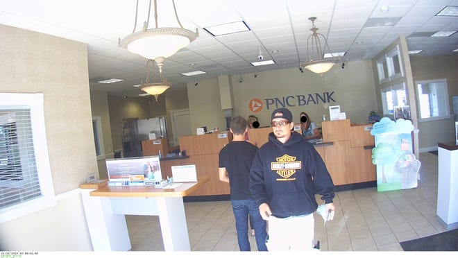 A surveillance photograph from the PNC Bank camera shows a man police later identified as Daniel Michael Miron.