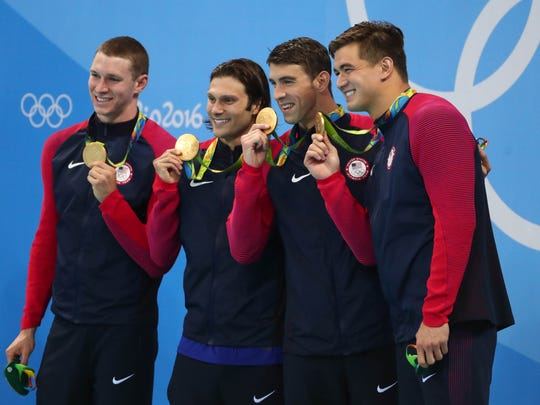 Nathan Adrian (right) with Michael Phelps, Cody Miller and Ryan Murphy after winning the 4×100 medley relay in Rio. (Rob Schumacher-USA TODAY Sports)