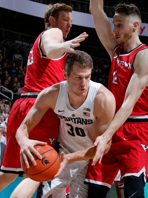 Michigan State's Matt Van Dyk (30) is pressured by Youngstown State's Brett Frantz, left, and Matt Donlan, right, during the second half of MSU's 77-57 win over Youngstown State Tuesday at Breslin Center.