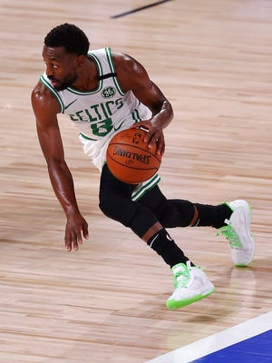 Kemba Walker of the Boston Celtics dribbles the ball down court after the game during the first quarter at The Arena at ESPN Wide World Of Sports Complex on August 11, 2020 in Lake Buena Vista, Florida.