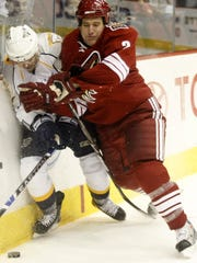 Phoenix Coyotes Ken Klee, right, hits Nashville Predators