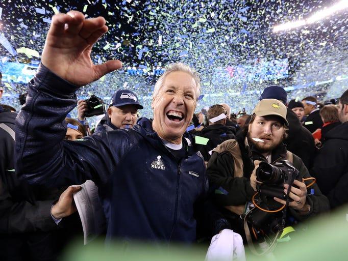 Seattle Seahawks head coach Pete Carroll celebrates after Super Bowl XLVIII against the Denver Broncos at MetLife Stadium.  Seattle Seahawks won 43-8.